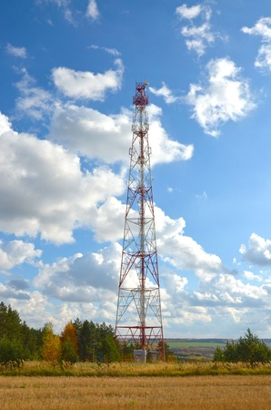Telecommunication tower against the blue sky, cell antenna, transmitter. Telecom TV radio mobile tower Stok Fotoğraf