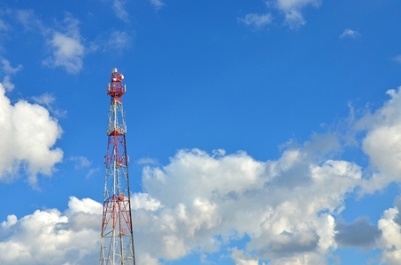 Telecommunication tower against the blue sky, cell antenna, transmitter. Telecom TV radio mobile tower Stock Photo