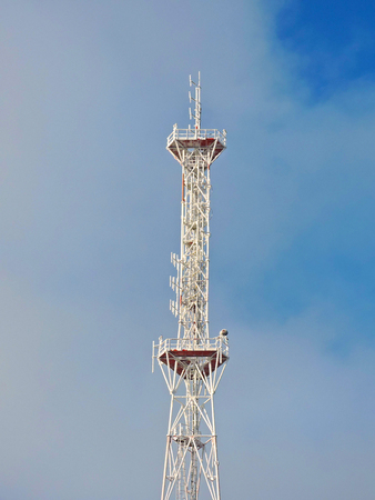 Cell antenna, transmitter. Telecom TV radio mobile tower against blue sky Stock Photo