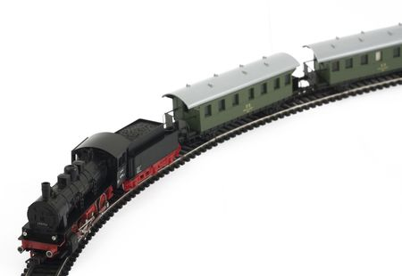 buffers: Toy steam locomotive and cars on white background Stock Photo