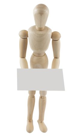 wooden mannequin holding a blank sign in hands  photo
