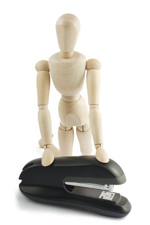 manequin: Wooden manequin with a black stapler on white background