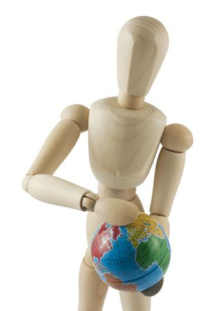 Wooden mannequin with a earth globe in hands on white background photo