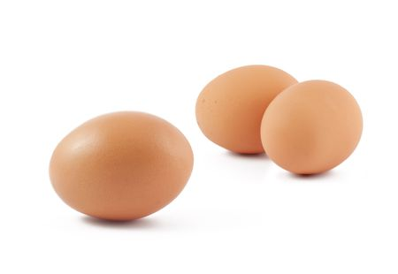 three objects: Three brown eggs isolated on white background