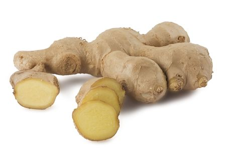 Whole and sliced ginger root isolated on white background
