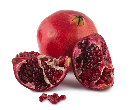 Fresh full and opened pomegranate on white background photo