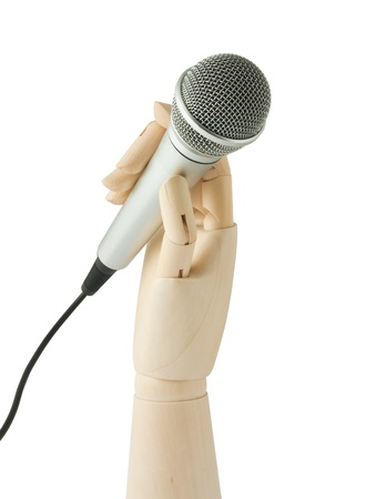 wooden hand holding a microphone on white background Stock Photo - 8564016
