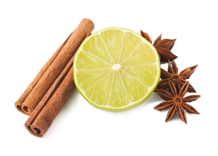 anis: Lime, cinnamon and anis isolated on white background