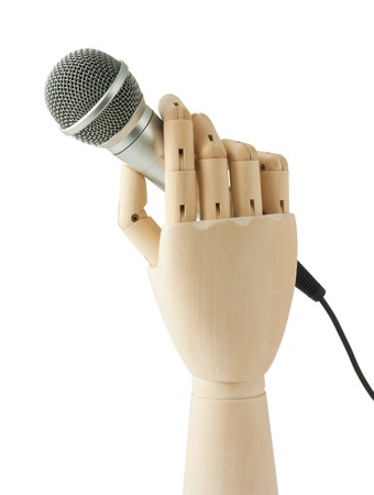 artificial model: wooden hand holding a microphone on white background Stock Photo