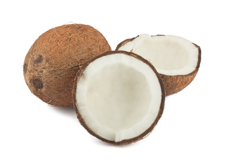 Fresh full and two halves of coconut isolated on white background photo