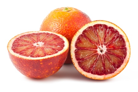 Full and two half of blood red oranges isolated on white background Stock Photo