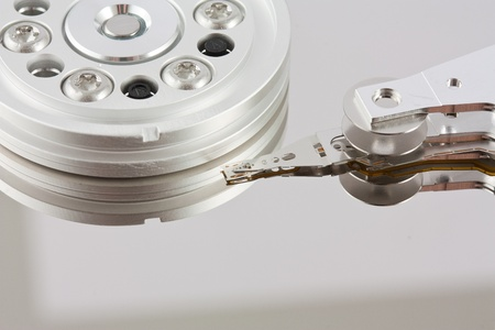 Closeup of the platters and head of a opened computer hard drive Stock Photo - 9067707