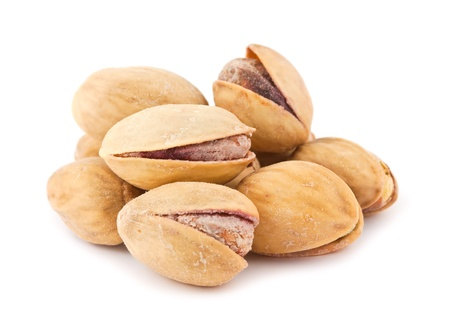 Dry salted pistachio nuts isolated on white background  photo