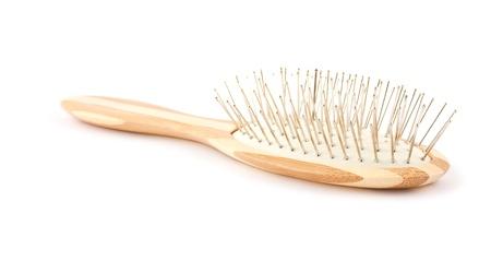 Wooden hairbrush isolated on white background  photo