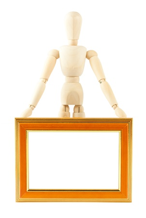 Wooden concept of mannequin in pose with wood frame Stock Photo - 9467489