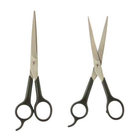 Closed and opened professional hircutting scissors isolated on white photo