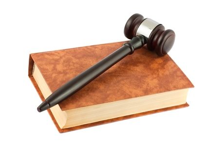 Brown book and gavel isolated on white background  photo