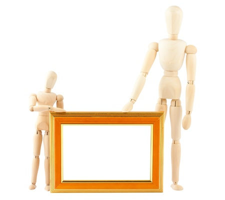 Two wooden dummy and empty frame isolated on white background photo