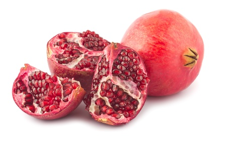 Full and open pomegranate isolated on white background
