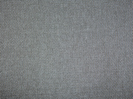 Grey fabric texture may be used as background photo