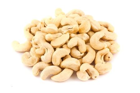 Ripe cashew nuts isolated on white background photo