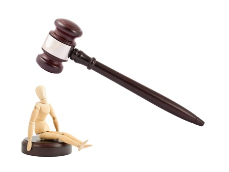 Judges gavel and wooden mannequin. Guilty concept. photo