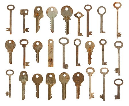 Collection of old used keys isolated on white background photo