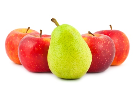 Four red apples and green pear isolated on white background photo