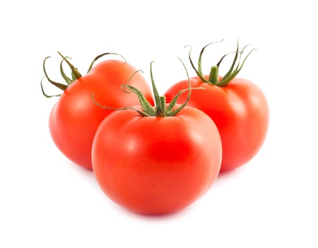 Three fresh red ripe tomatoes isolated on white background photo