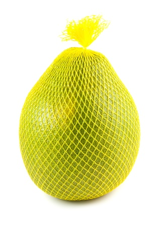 Pomelo fruit wrapped in a yellow plastic isolated on white Stock Photo - 9824448