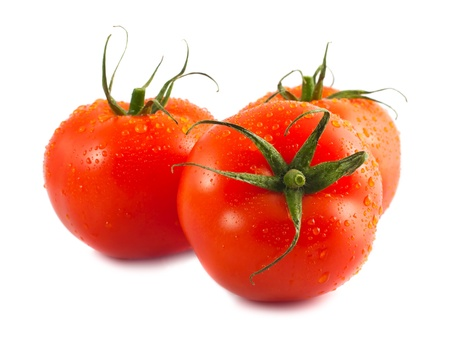 Three fresh wet tomatoes isolated on white background photo