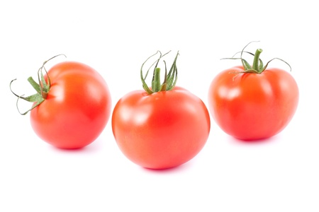 Three fresh ripe tomatoes isolated on white background  photo