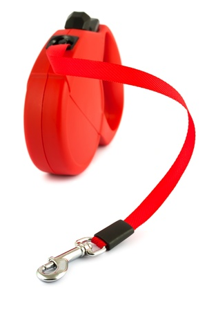 vehicle accessory: Red retractable leash for dog isolated on white background