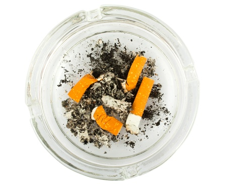 Top view of a glass ashtray with stubbed out cigarette butts  photo