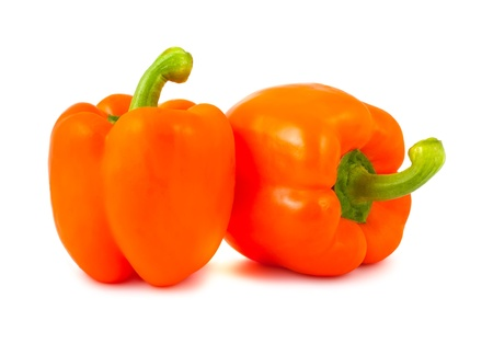 Two ripe orange peppers isolated on white background photo