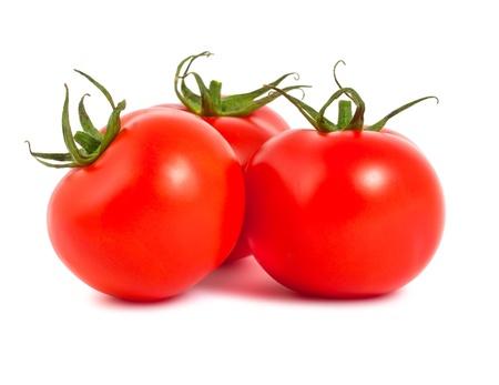Three fresh ripe tomatoes isolated on white background photo