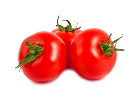 Three red ripe tomatoes isolated on white background photo