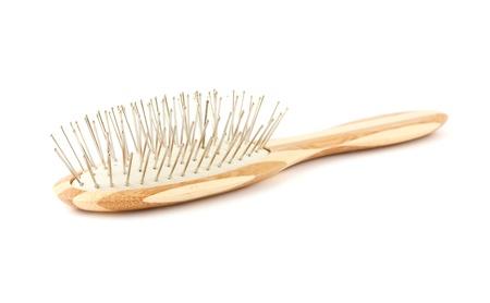 Single bamboo hair brush isolated on a white background.  photo
