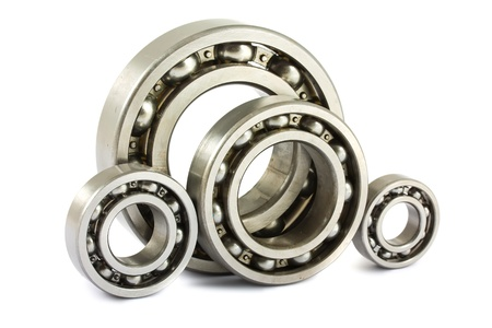 machine part: Four steel ball bearings isolated on a white background