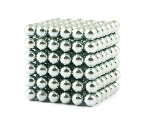 Cube assembled from little metallic magnetic balls isolated on white  photo