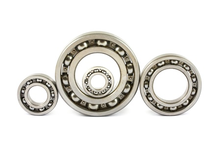 Four steel ball bearings isolated on a white background photo