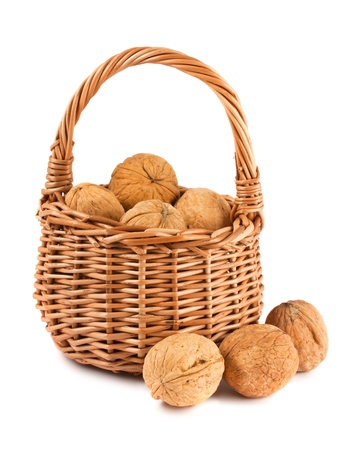Wicker basket with walnuts isolated on a white background  photo
