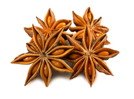 badiane: Anise stars isolated on a white background   Stock Photo