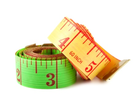 Two measuring tapes isolated on white background photo