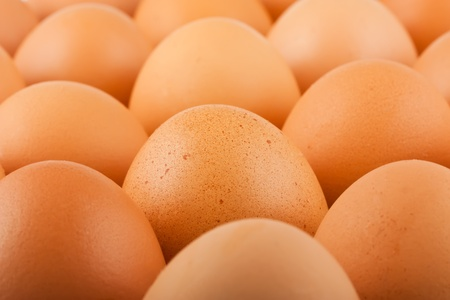 macros: Group of brown chicken eggs. May be used as background.
