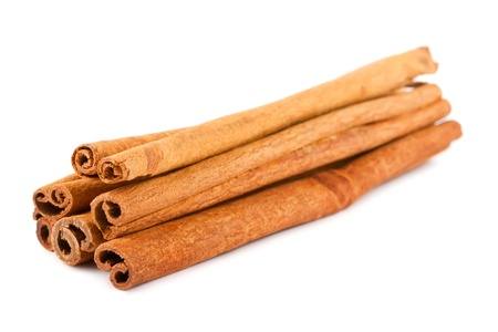 backing up: Cinnamon sticks isolated on white background  Stock Photo