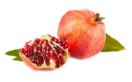 Ripe pomegranate with leaves isolated on white background photo
