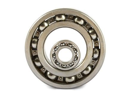 Big and small ball bearings on white background