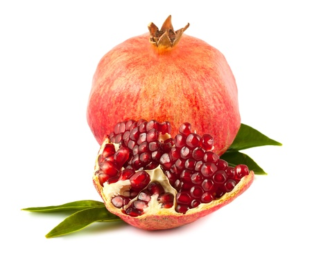 grenadine: Ripe pomegranate with leaves isolated on white background