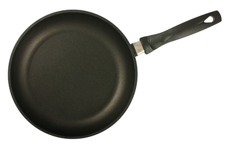 Black frying pan isolated on white background. Top view.  photo